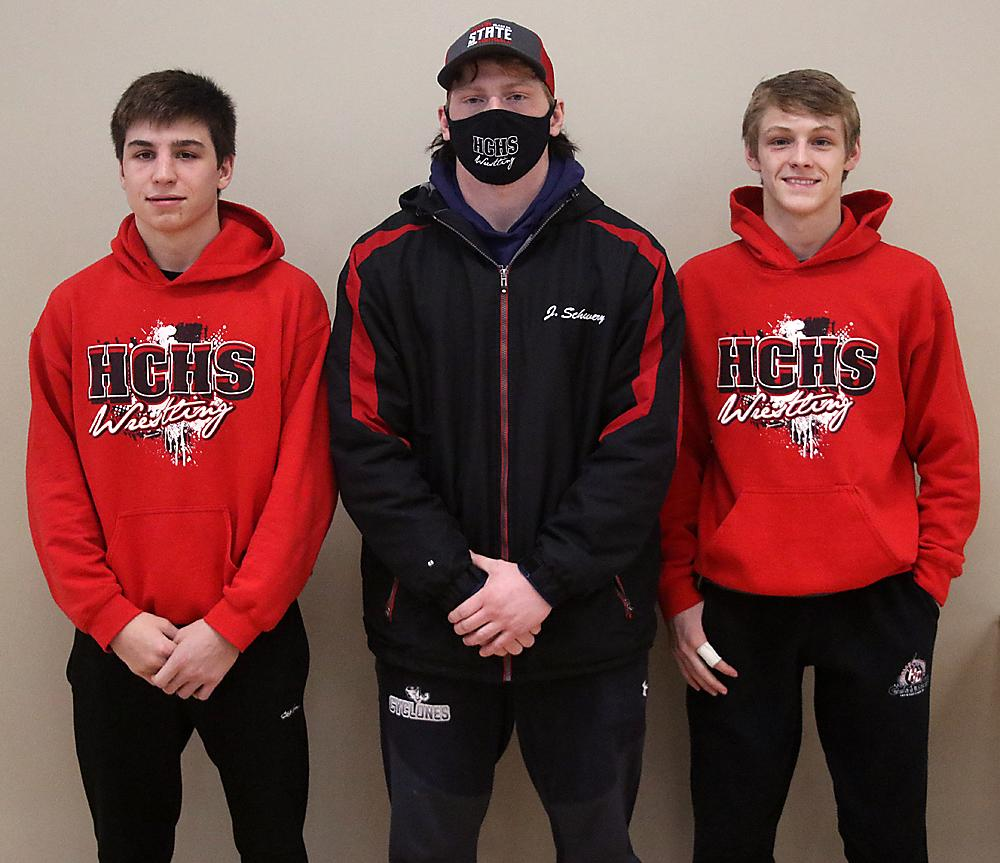 ON TO STATE -- Left-right: Harlan Community's three state wrestling qualifiers this year are junior Luke Musich (126 pounds), senior Jesse Schwery (195) and junior Luke Freund (113). All three placed second in their weight class at Saturday's Class 2A District Tournament in Sioux City. (Photo by Mike Oeffner)