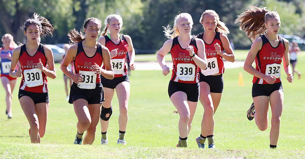 PACK ATTACK -- Nearly halfway through Saturday's Cyclone Cross Country Invite, six Harlan Community girls maintain their pack at the Harlan Golf and Country Club. The HCHS girls placed first with a team score of 42. Left-right: Abi Baldwin, Kaia Bieker, Brecken Van Baale, Greichly Kaster, Raegen Wicks and Lucy Borkowski. (Photos by Mike Oeffner)