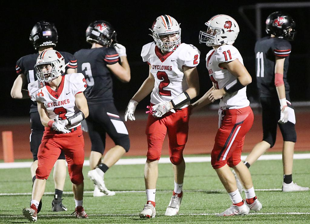 HCHS junior quarterback Teagon Kasperbauer (right) celebrates one of his seven touchdown passes with Connor Frame (2) and Joey Moser.