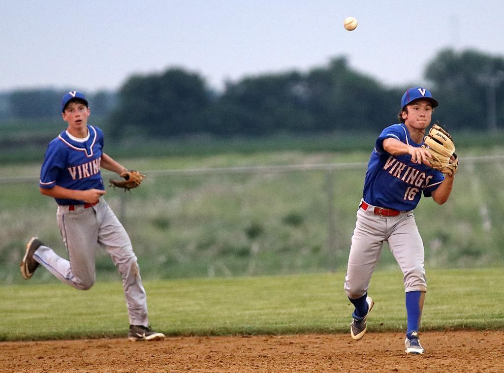 AHSTW second baseman David Johnson (16) throws out a runner as shortstop Nick Denning looks on.