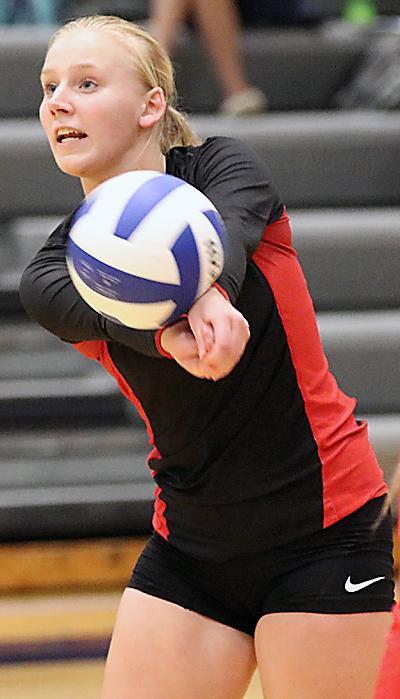 HCHS junior Elise Juhl makes a serve receive pass.