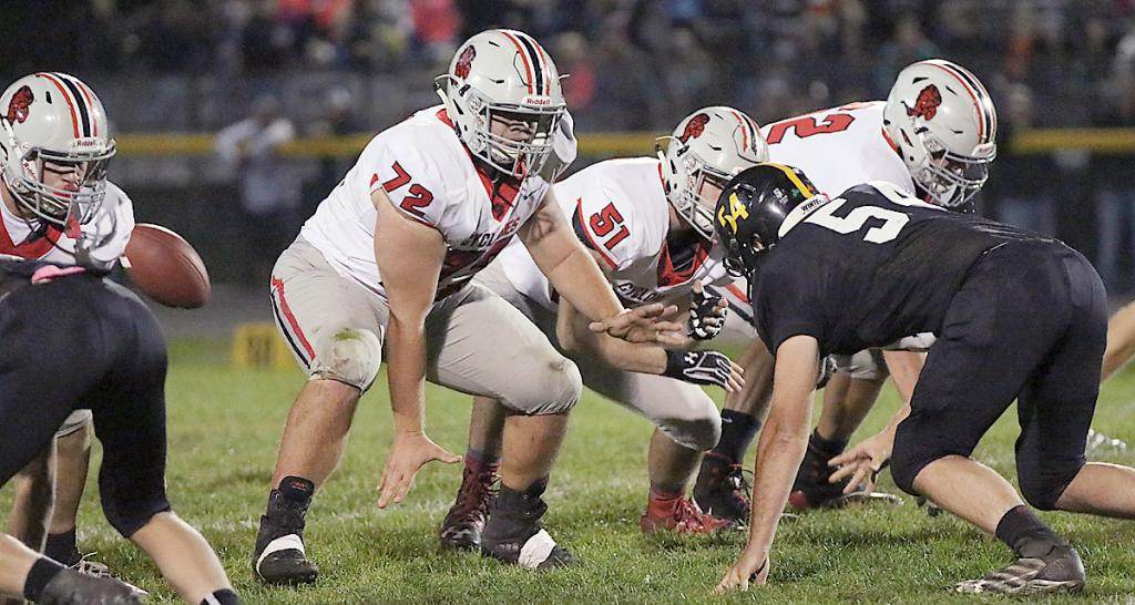 HCHS center Ethan Leinen (72) snaps the ball against Winterset in Week 9, flanked by Carter Bendorf (51) and Derec Weyer to his left. Leinen is a three-year starter for the Cyclones, who will take on 7th-ranked Oskaloosa in the first round of the 3A playoffs October 26.
