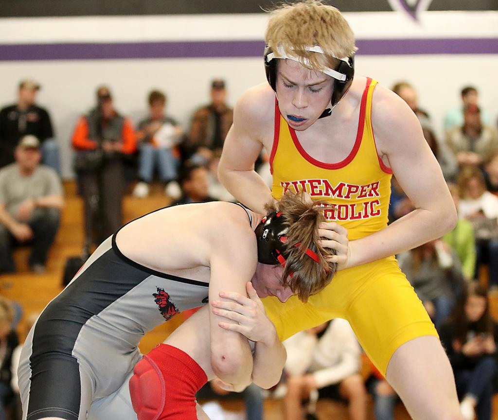 HCHS junior Ethan Lemon (left) gets in a shot on Kuemper Catholic's Shea Parkis during their 126-pound sectional championship match. Lemon won by fall in 4:46.