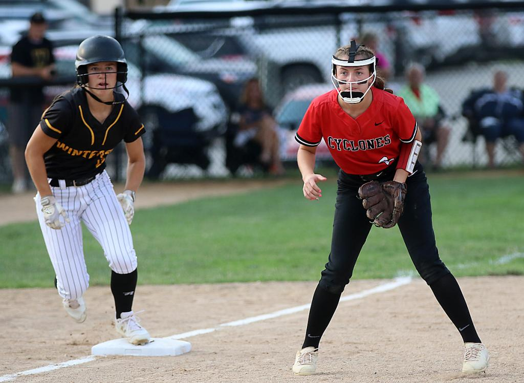 Cyclone third baseman Ella Plagman (right) gets ready to field her position as a Winterset runner leads off the bag.