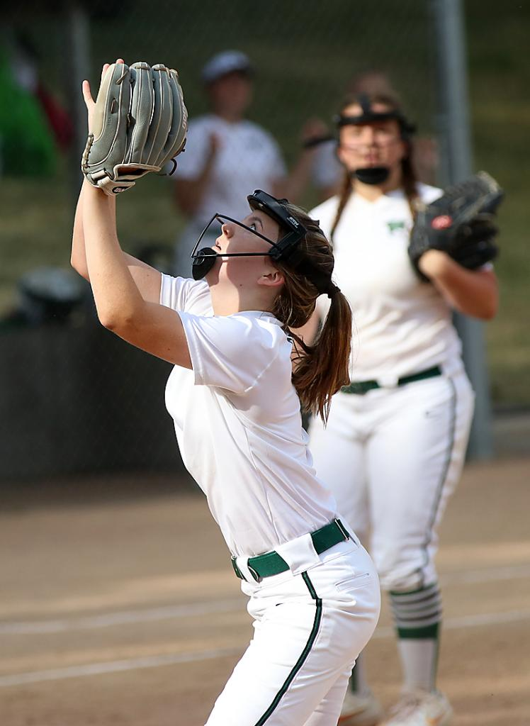 Wolves' pitcher Ella Richards takes charge to haul in an infield pop fly.