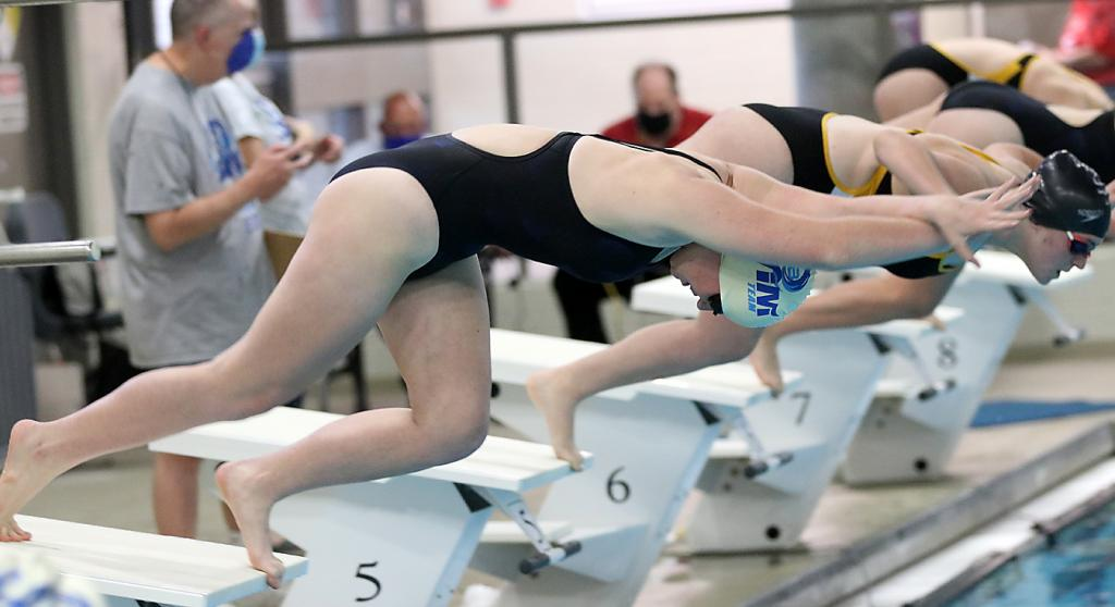 Elaina Vrchoticky dives into the pool at the start of a race.
