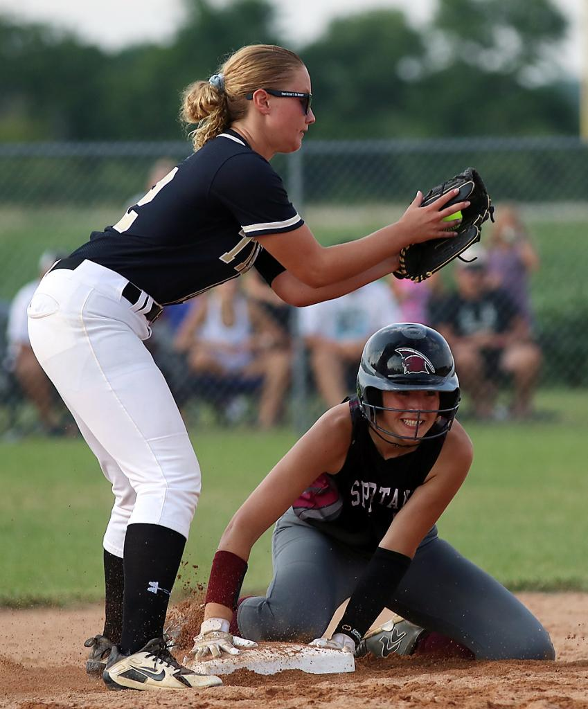 Exira-EHK junior Macy Emgarten (right) is all smiles at second base after tying Friday's game with a seventh-inning RBI single.