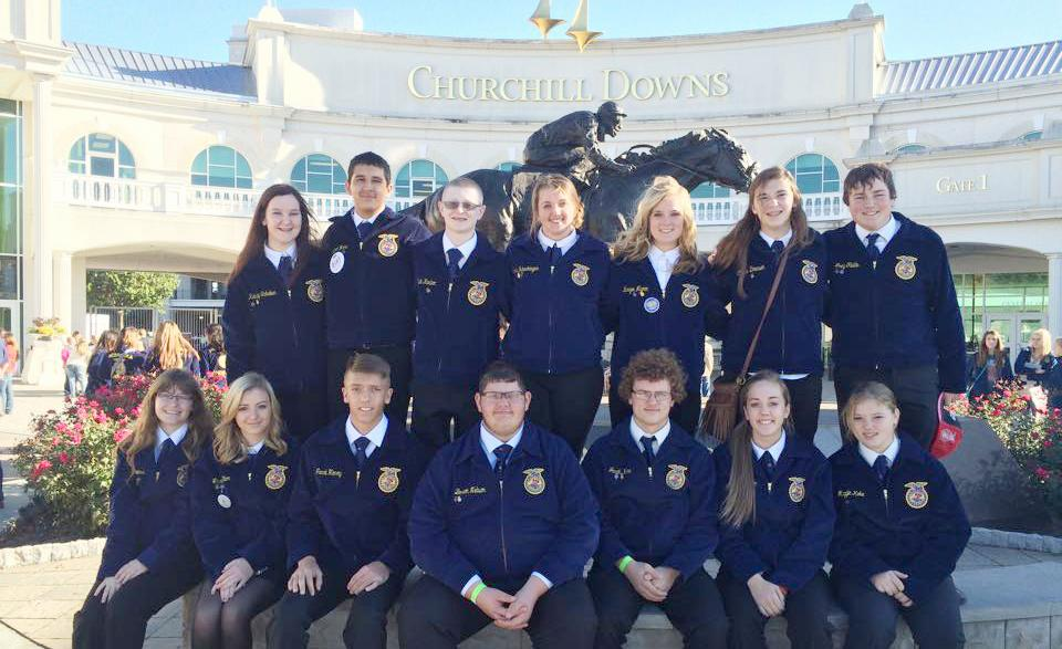 Harlan FFA members pictured at the Churchill Downs horse racing track L to R, front row: Megan Owens, Lauren Blum, Jacob Henry, Brandon Nelson, Jacob Koke, Abby Schechinger, and Maggie Koke.  Back row: Kelsey Schaben, Miguel Mena, Kaleb Kaster, Jamie Schechinger, Kenzie Mumm, Claire Dresen, and Joey Fields.