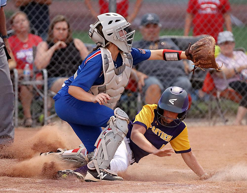 AHSTW catcher Rylie Knop takes a throw from shortstop, but not before Logan-Magnolia's Kali Collins is able to slide home with the winning run in the eighth inning of Thursday's Western Iowa Conference Tournament semifinal.