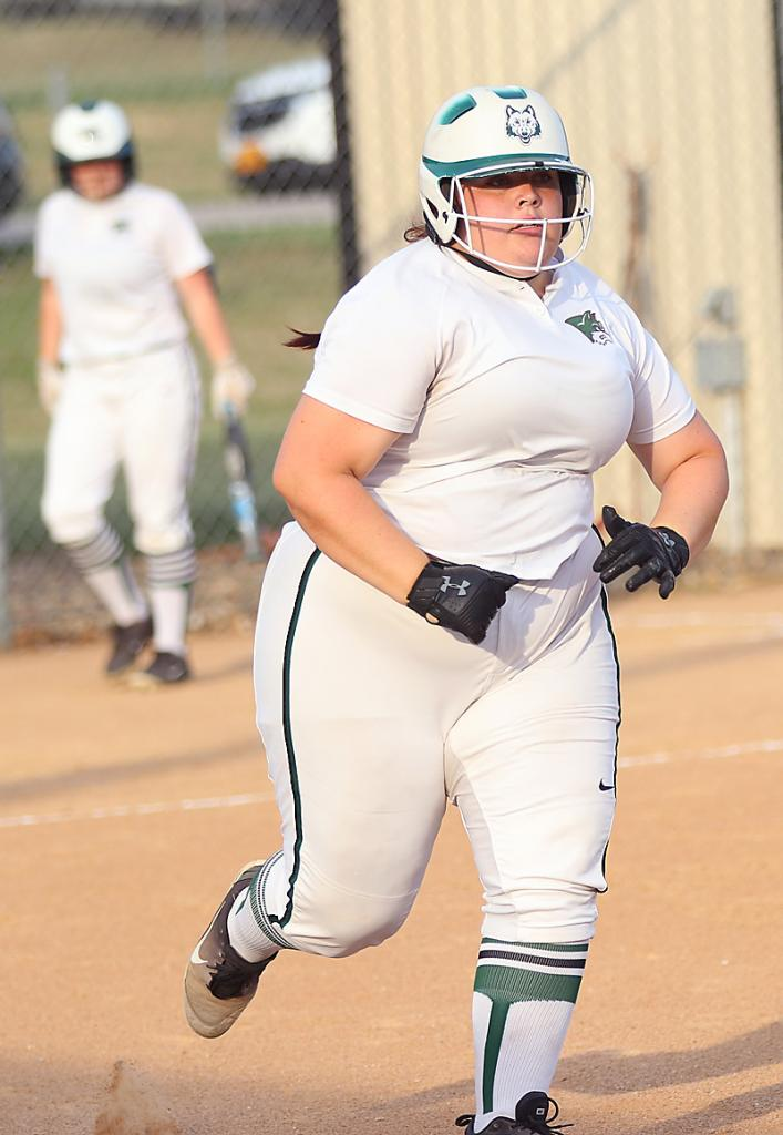 IKM-Manning senior Erin Fineran runs to first base after putting the ball in play against ACGC.