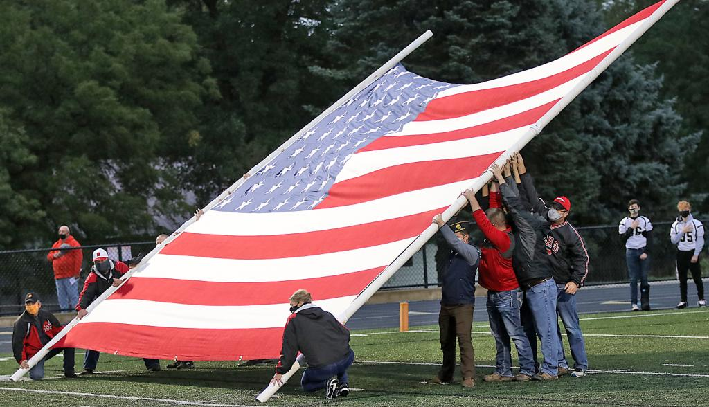 The US flag is proudly displayed during the playing of the national anthem by the Cyclone marching band.