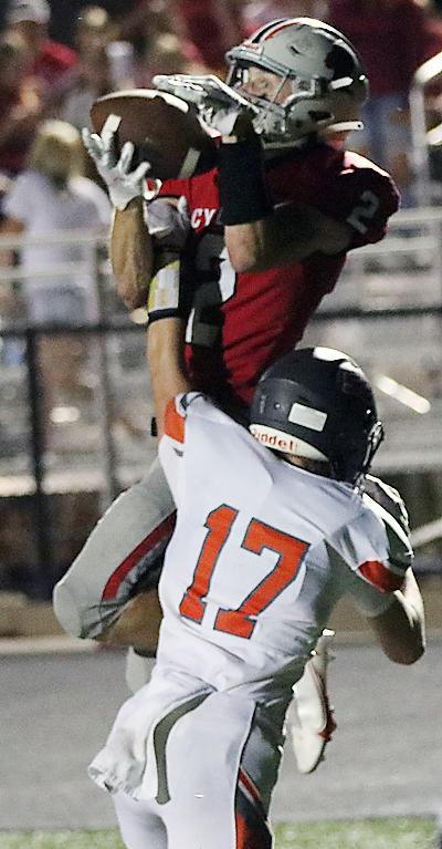 Cyclone receiver Connor Frame leaps over SB-L's Scott Kroll (17) to catch a third-quarter touchdown pass from Teagon Kasperbauer.