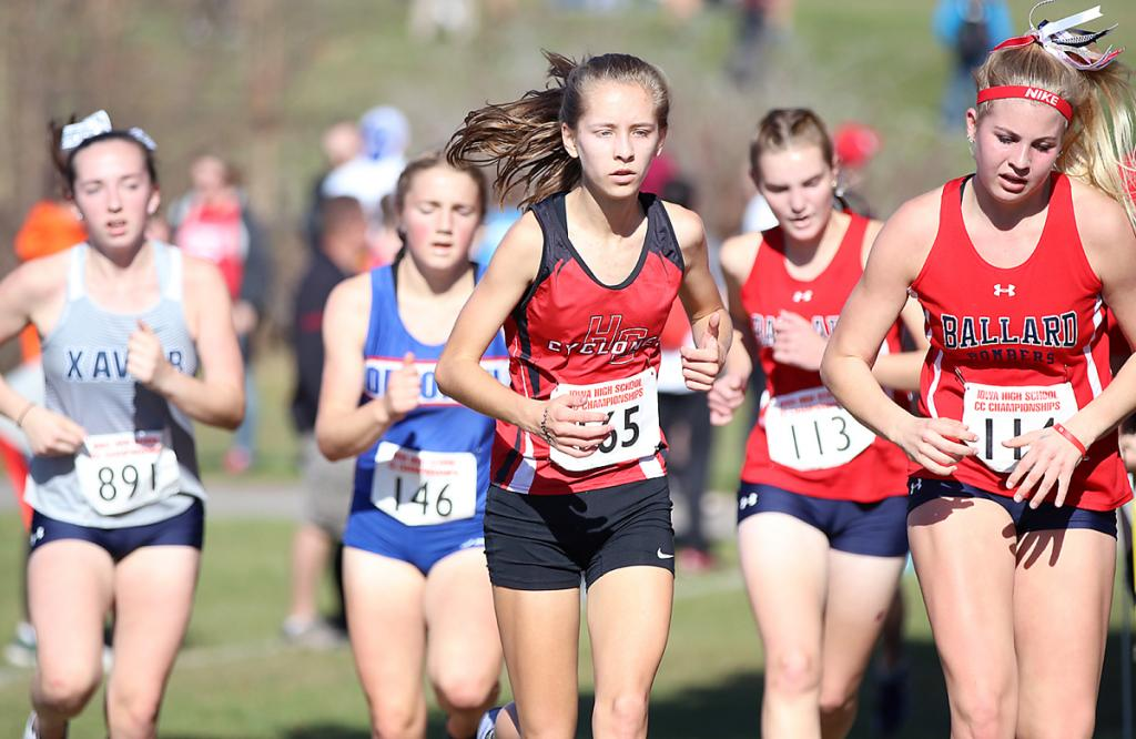 HCHS sophomore Liv Freund (center) competes in her first state cross country meet on Saturday.
