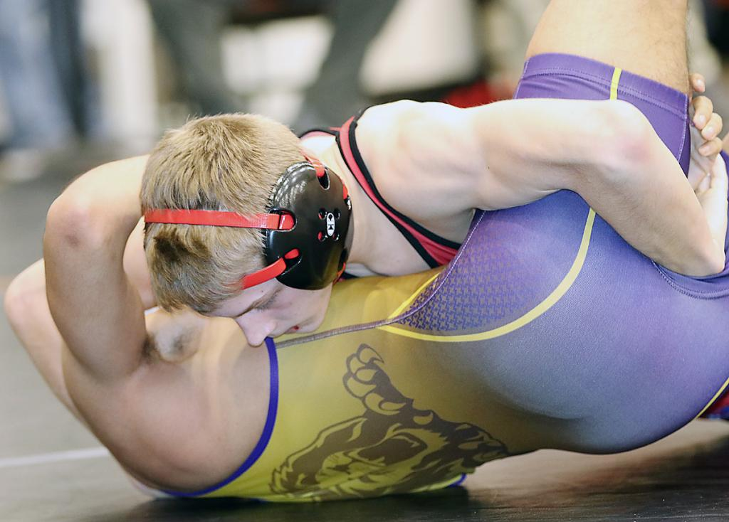 Harlan Community sophomore 113-pounder Luke Freund pins Denison-Schleswig's Hugo Medina in a consolation semifinal. Freund placed third on the day.