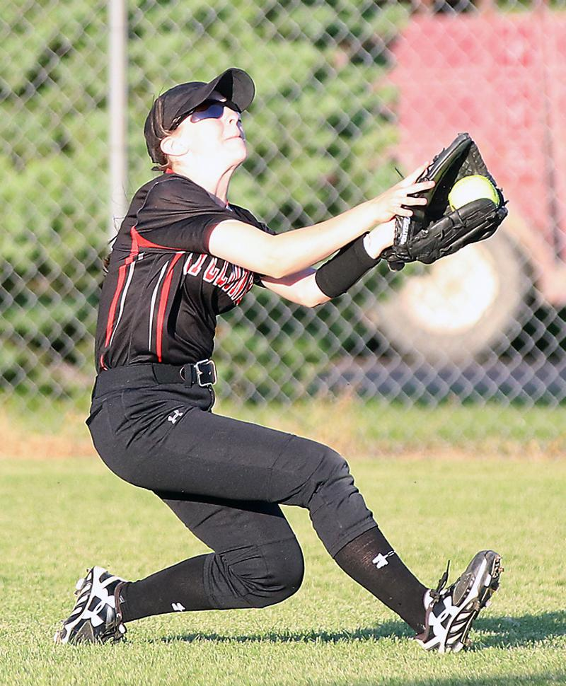 HCHS sophomore Miranda Goetz makes a sliding catch in the right-center field gap to rob Shenandoah of a base hit during game two of Thursday's doubleheader.