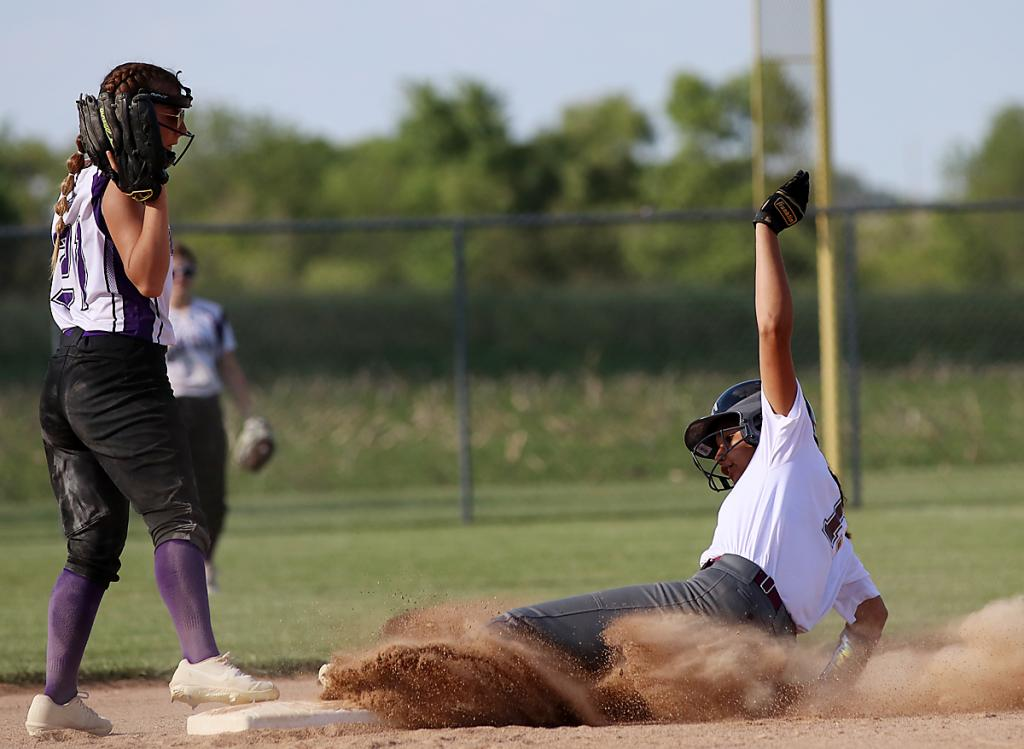 Exira-EHK's Gemini Goodwin slides safely into second base as Danyelle Hilkins catches the ball for Boyer Valley during Friday's RVC softball game.