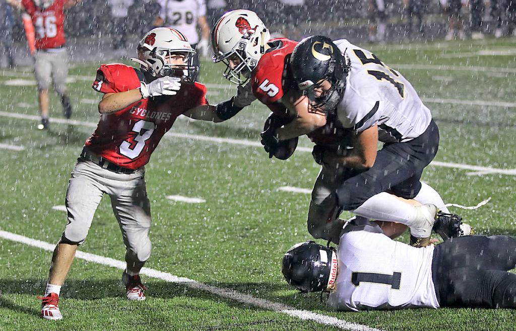 With some encouragement from Joey Moser (3), HCHS senior Mason Griffith powers across the goal line for the go-ahead touchdown vs. Glenwood Friday night with 4:58 left to play. (Photos by Mike Oeffner)