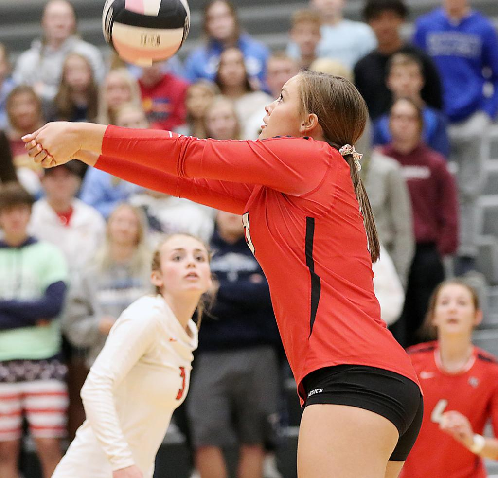 HCHS senior Haley Manz keeps a point alive against Lewis Central as teammates Ashley Hall (left) and Zophi Hendricks look on.