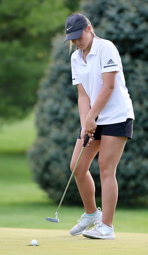 HCHS junior Haley Manz sinks a putt.