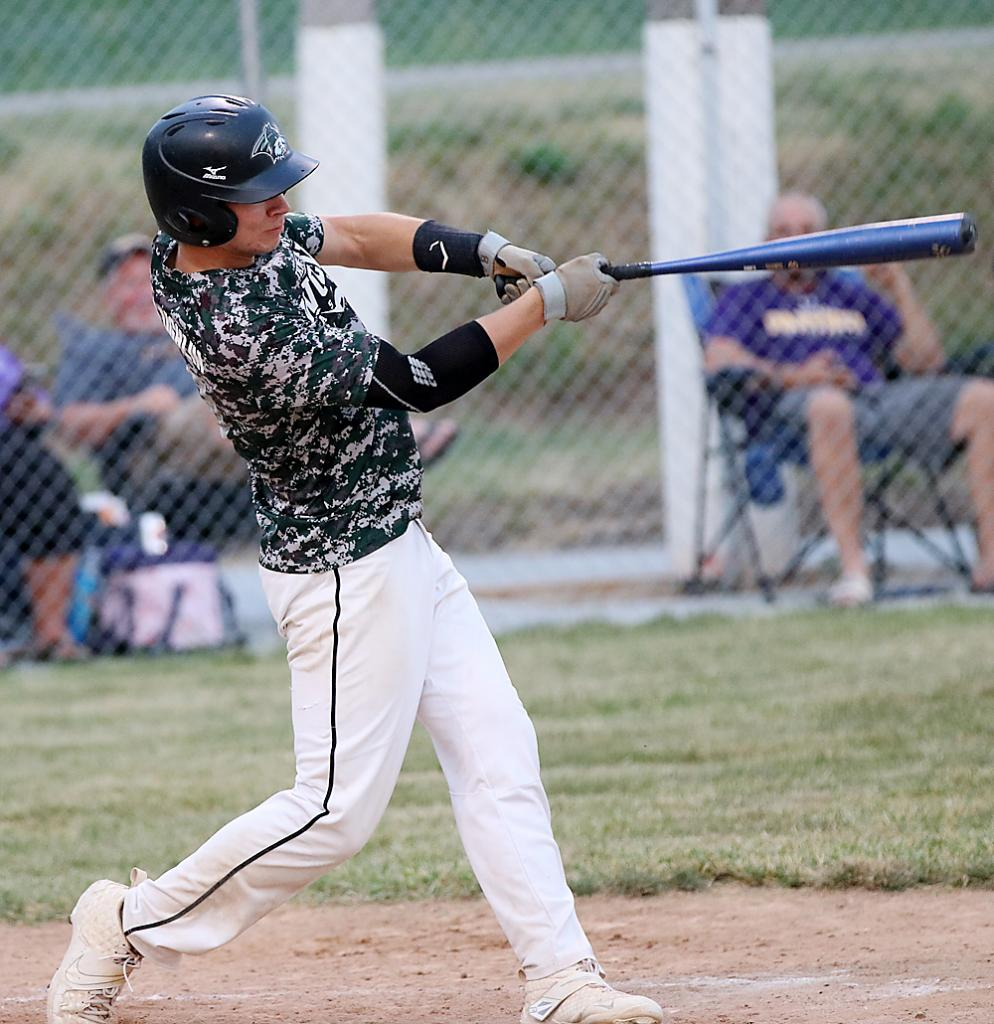 IKM-Manning senior Hayden McLaughlin hits a solo home run during the fourth inning of Friday's game against Logan-Magnolia. McLaughlin added an RBI double in the fifth but the Wolves were defeated 18-5. (Photos by Mike Oeffner)