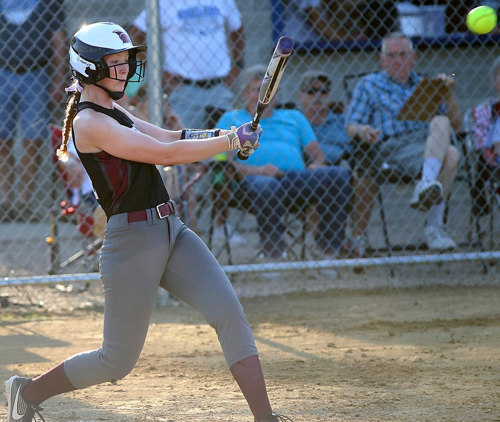 Spartan first baseman Hannah Nelson hits a second-inning single for one of the team's five hits vs. Mustang pitcher Kierra Jungers.
