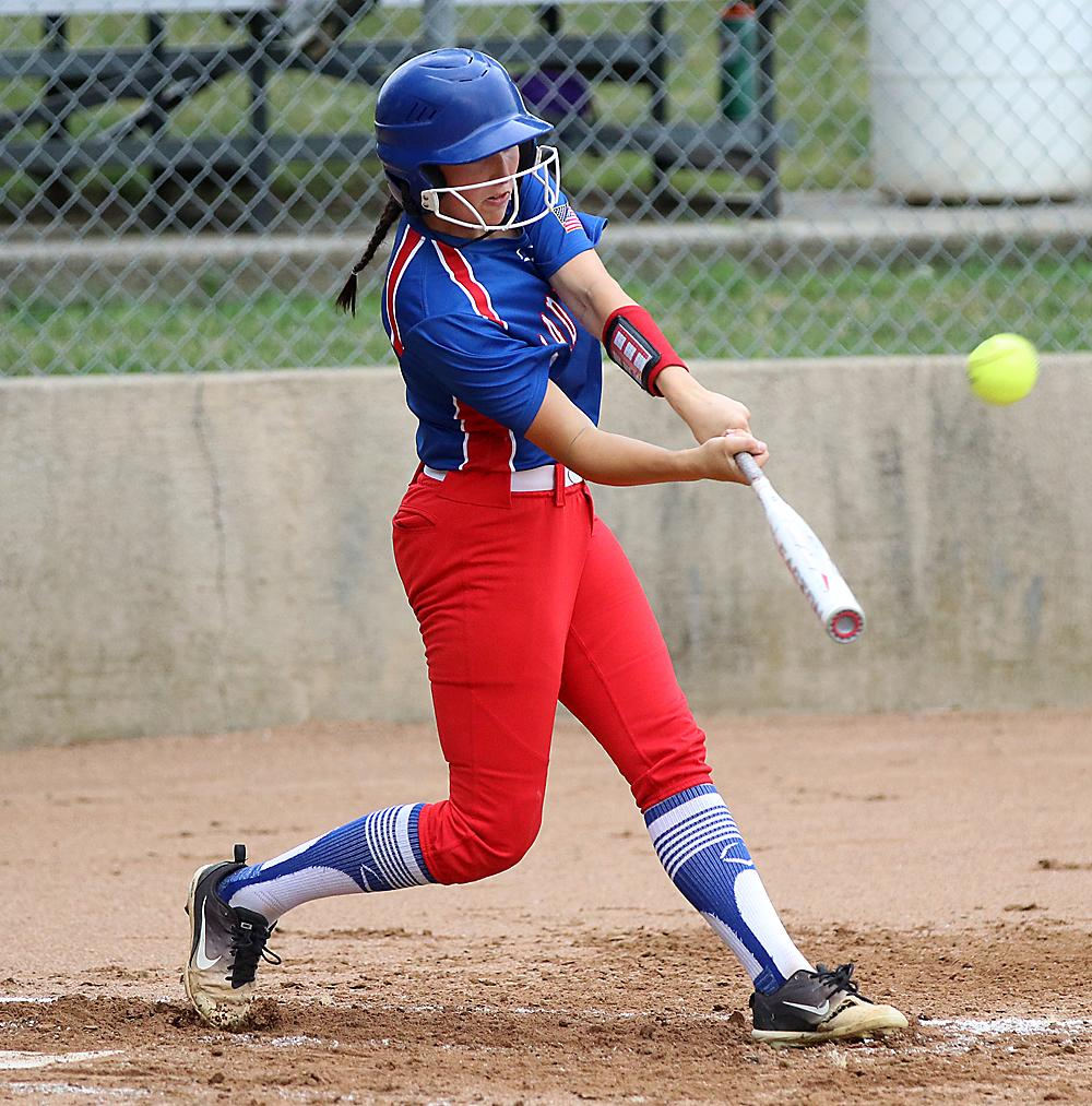 AHSTW's Natalie Hagadon connects for a two-run homer during Thursday's 11-1, five-inning win over IKM-Manning. (Photos by Mike Oeffner)