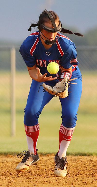 Lady Vike shortstop Natalie Hagadon finds the handle on a Trojan ground ball.