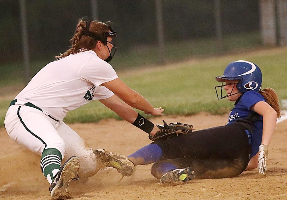 IKM-M third baseman Sammy Halbur tags out Underwood's Grace Pierce at third base. Halbur tagged out two Eagle base runners in the game. (Photos by Mike Oeffner)