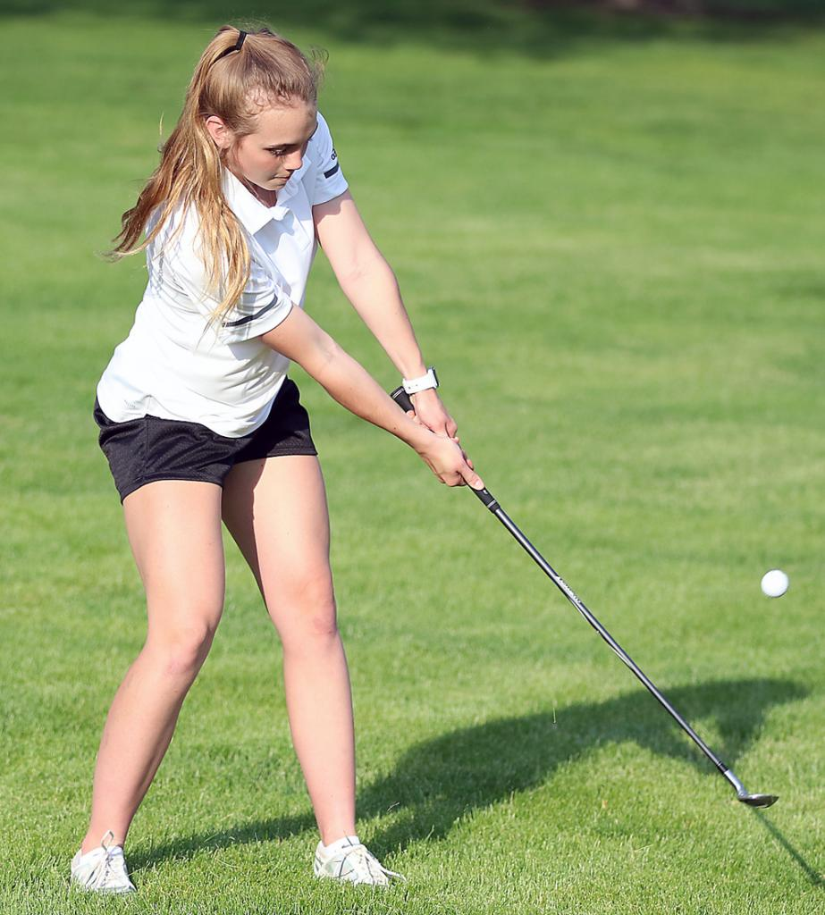 HCHS sophomore Ashley Hall chips toward the number nine green at Harlan Golf and Country Club.