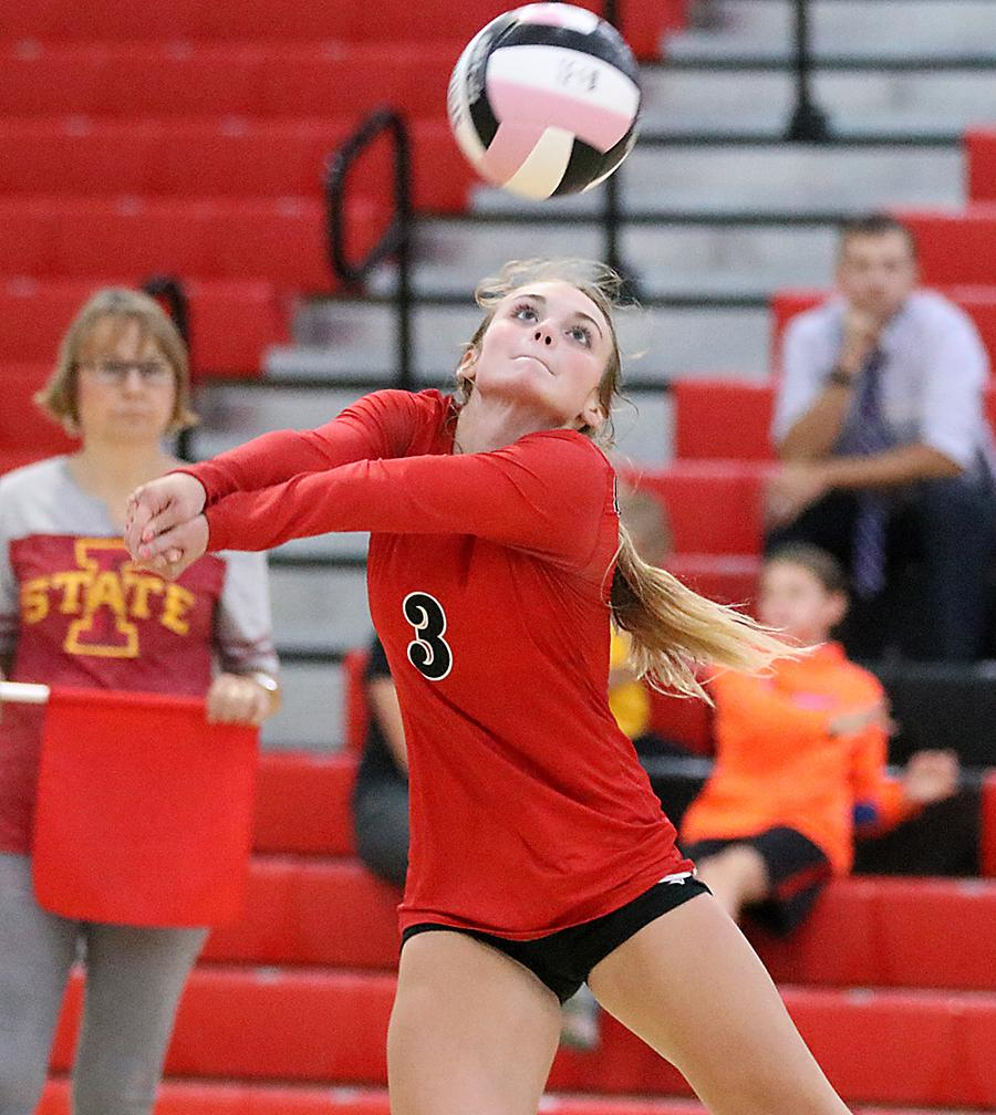 Sophomore libero Ashley Hall makes one of her team-high 22 digs in Harlan's 3-1 win over the Fillies.