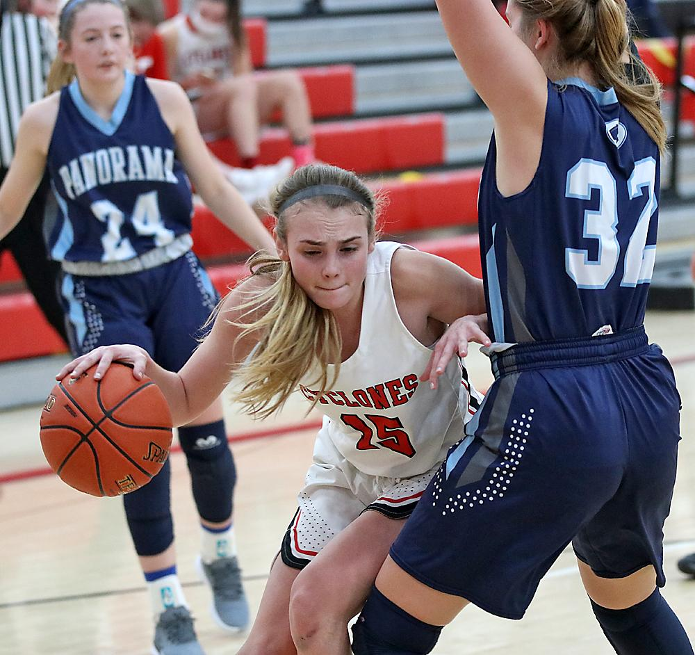 HCHS senior Ashley Hall (center) is blocked from the basket by Panorama's Angel Poldberg during Monday's non-conference game.