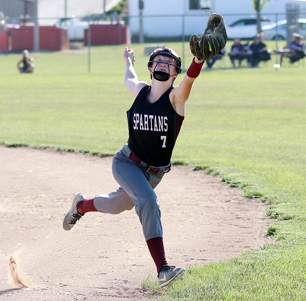 Spartan second baseman Kate Hansen makes a nice running catch to rob a Nodaway Valley player of a hit. (Photos by Mike Oeffner)
