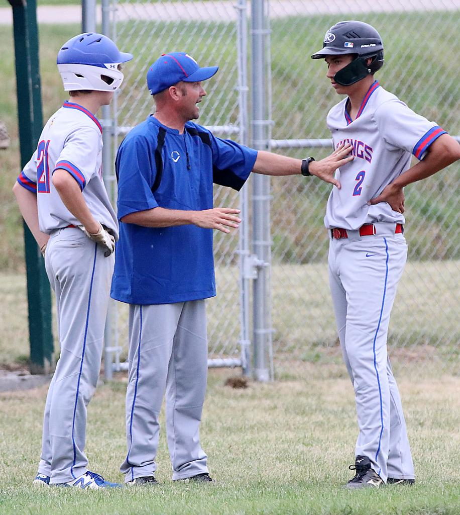 AHSTW head coach Jason Holst (center) talks with Jonas Rieder (2) and Caleb Hatch during an IKM-Manning defensive conference.