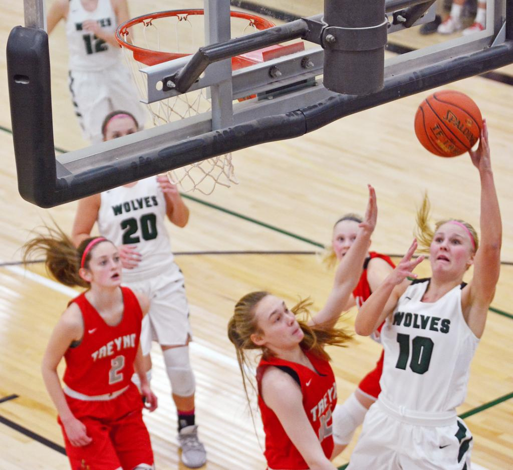 Alexa Ahrenholtz (10) puts up a shot for the Wolves.