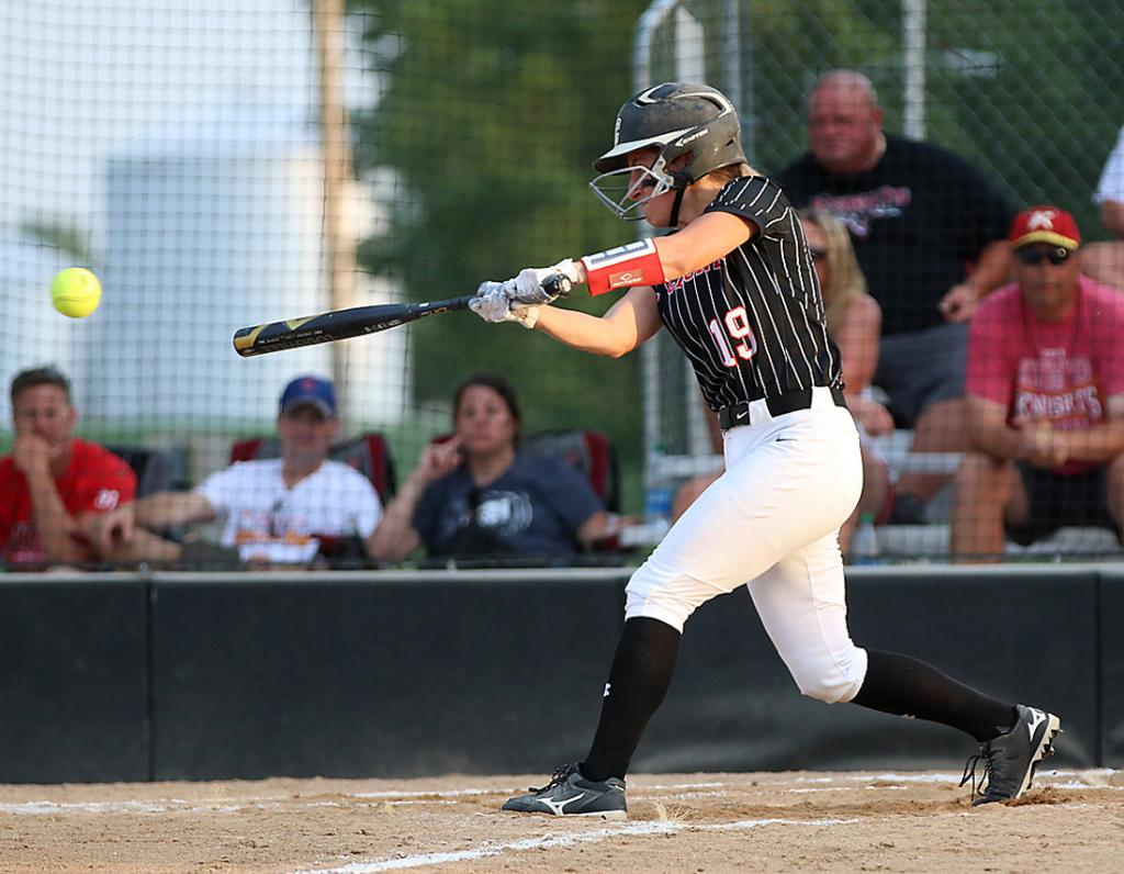 HCHS senior Kennedy Kjergaard connects for a two-out single during the second inning of Thursday's 5-3 home win over Kuemper Catholic.