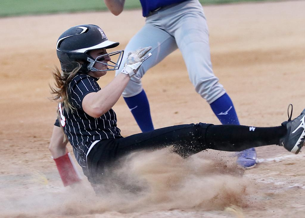 HCHS senior Kennedy Kjergaard slides home safely on a wild pitch to score the second run of the Cyclones' 2-0 win over AHSTW.