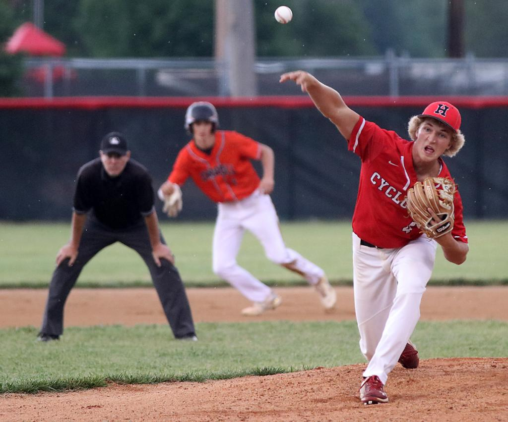 HCHS sophomore Teagon Kasperbauer delivers a pitch on Tuesday as a Carroll runner leads off second base. Kasperbauer worked his second complete game shutout of the season as the Cyclones beat the Tigers 5-0.