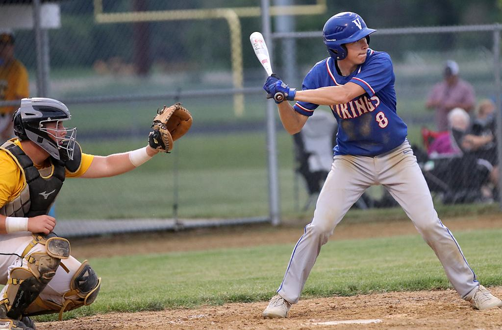 AHSTW's Jake Kelly (8) looks to swing away during Friday's Western Iowa Conference game vs. Tri-Center. (Photos by Mike Oeffner)