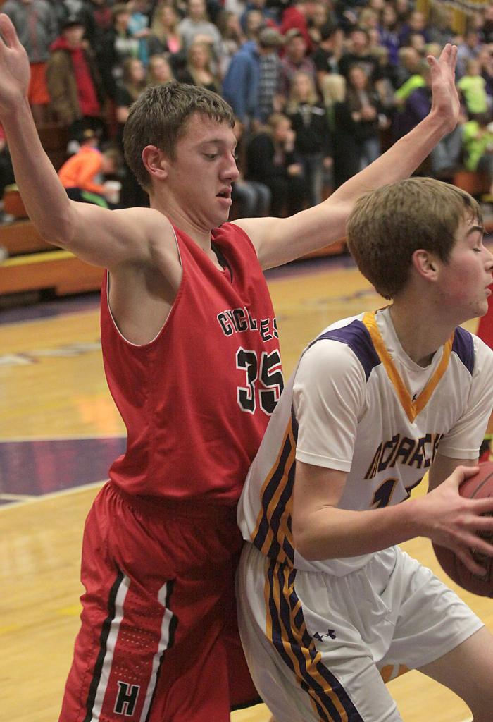 HCHS senior Ethan Knudson (left) defends Denison-Schleswig's Hunter Lilleholm on the low block during Friday night's Cyclone victory. (Photos by Mike Oeffner)