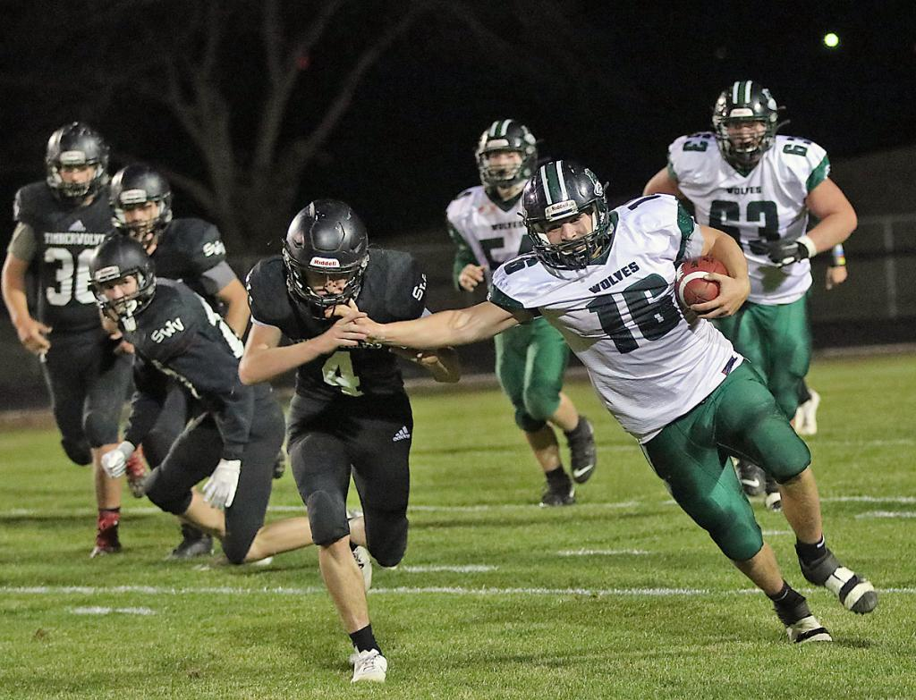 IKM-Manning's Kyler Rasmussen (right) stiff-arms Blake Thomas of Southwest Valley on a 35-yard run during the second quarter Friday. (Photos by Mike Oeffner)
