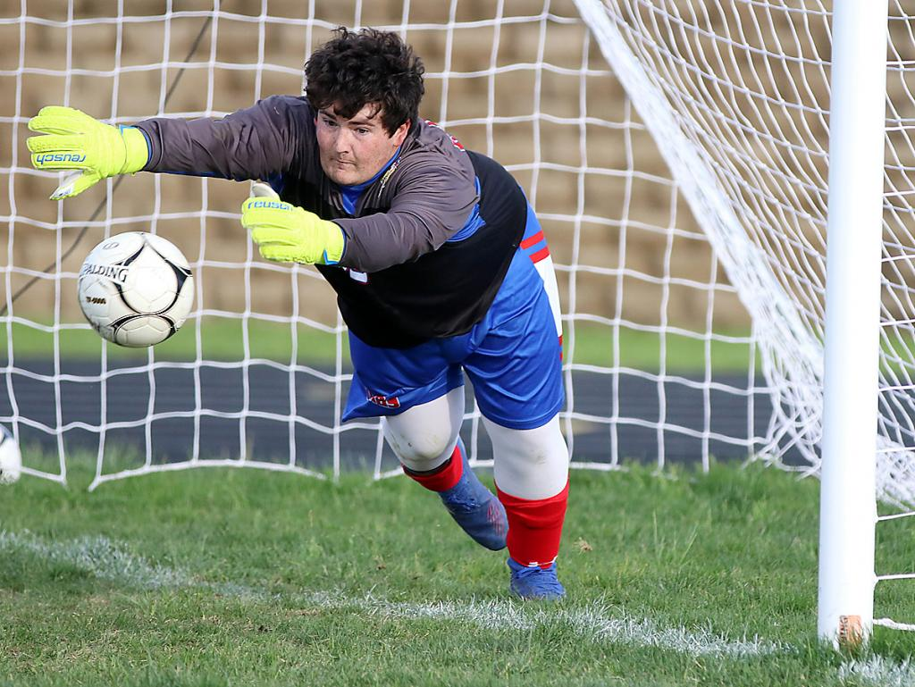 AHSTW goalie Lucas Young makes one of his three saves during Wednesday night's penalty kick shootout vs. Underwood.