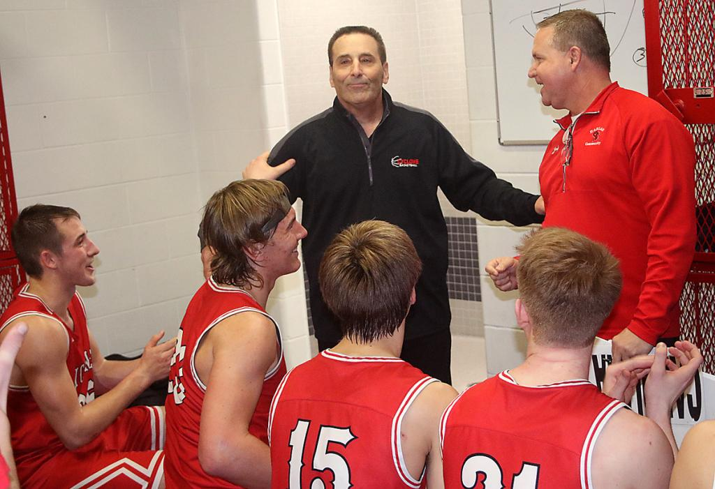 Harlan Community head coach Mitch Osborn (center) reacts to assistant coach Chad Swanson in the locker room following the Cyclones' 68-60 win at Creston Friday night. Osborn became just the fourth coach in state history to reach the 700-win mark. HCHS players, left-right, include: Johnathan Monson, Will McLaughlin, Connor Bruck and Michael Erlemeier.