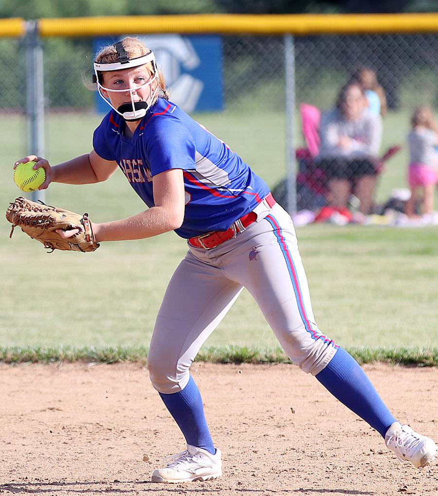 AHSTW shortstop Madison Heiny looks to throw out a runner at first.