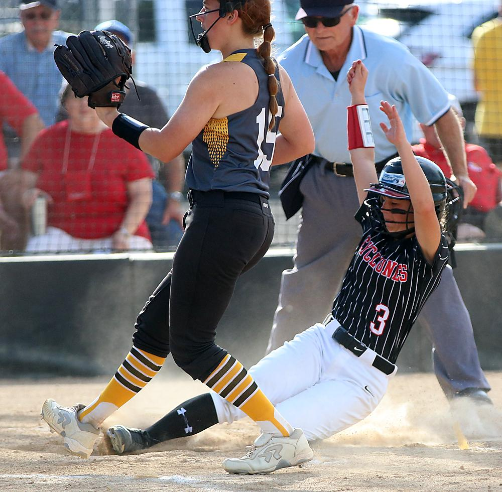HCHS sophomore Madison Kjergaard (3) scores on a wild pitch to give the Cyclones a 4-0 lead in the third inning against Atlantic.