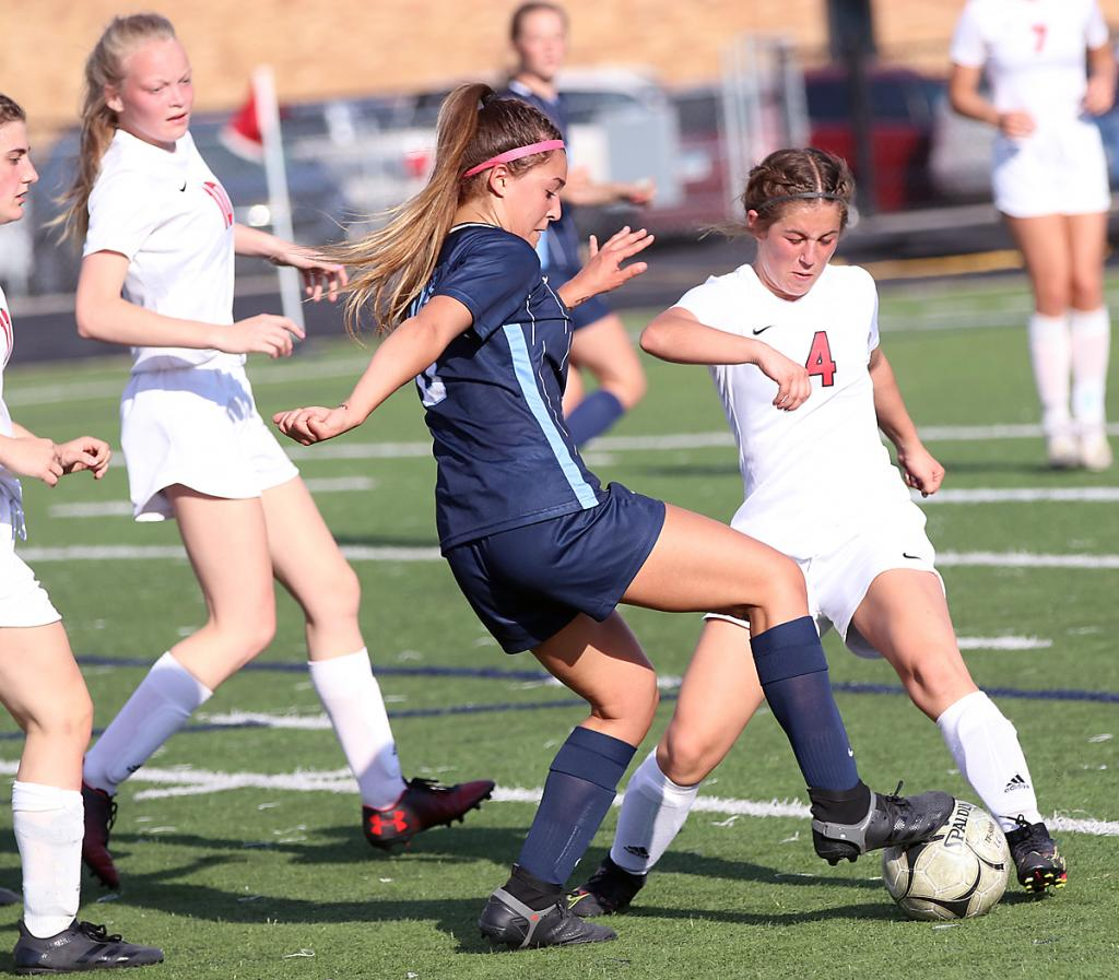 Cyclone sophomore Madison Kjergaard (4) stays on the feet of Lewis Central's Hana Daoudi during first-half action.