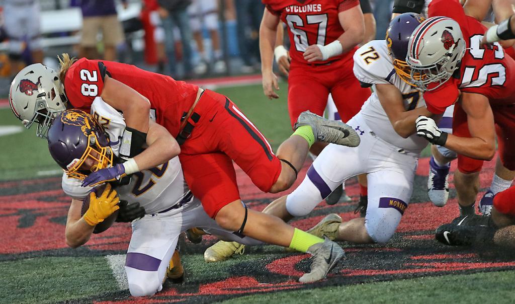 HCHS linebacker Will McLaughlin slams into Denison ball carrier Jaxson Hildebrand during Friday's first quarter. (Photos by Mike Oeffner)