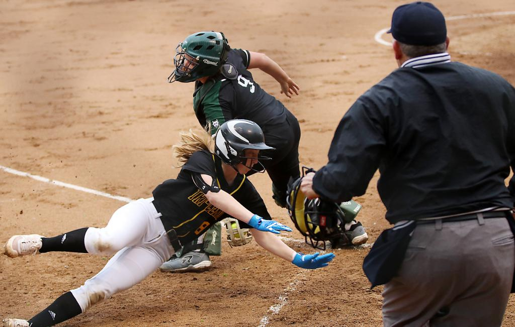 IKM-Manning catcher Zoey Melton tags out Tri-Center's Hope McPhillips at the plate. (Photos by Mike Oeffner)