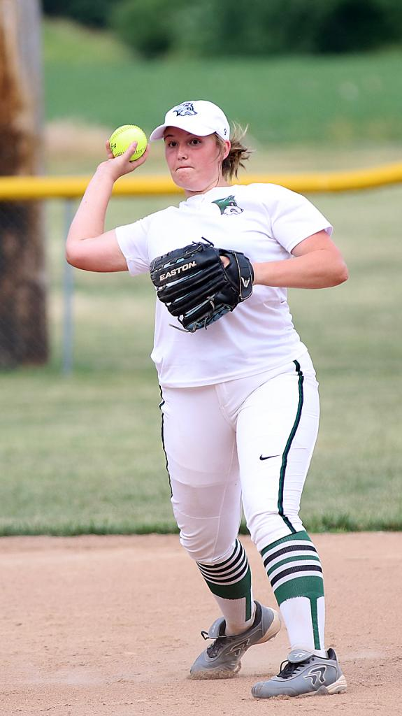 Shortstop Zoey Melton makes a strong throw to first for the Wolves.