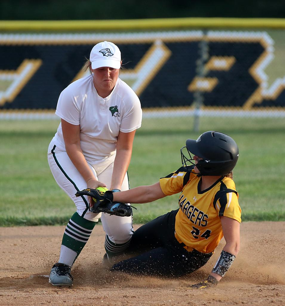 Wolves' shortstop Zoey Melton (left) tries to tag out ACGC's EmmaKay McClain at second base. McClain was called safe on the play.