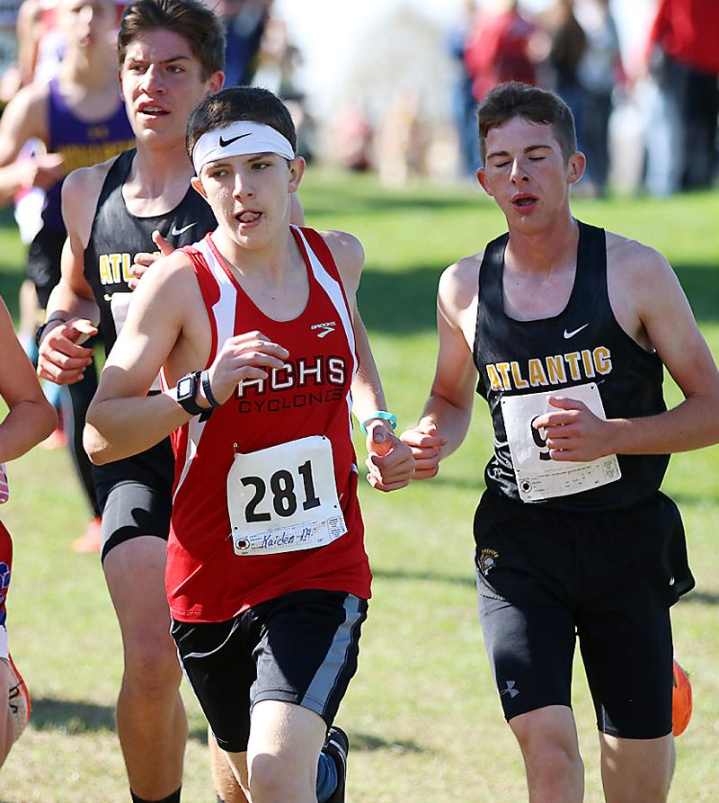 Kaiden Milliken (center) finished in 60th for the HCHS boys.